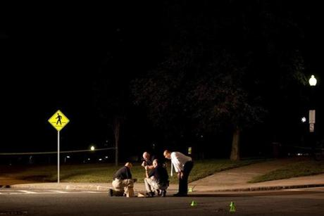Police investigators looked at evidence at the scene of the shooting where a man was shot multiple times at Winter and Adams streets in Allen Park on Aug. 17.