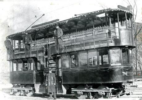 December, 1891: A photo submitted by Globe reader John C. Parsons of Dedham in 1964 showed a double-decked street car operated by the West End Railway Co., which ran from North Ave. Cambridge to North Stable, afterward known as the North Cambridge barn. The upper deck had a roof, but no sides. The West End Railway founded in 1887 was the preeminent street car system for the Greater Boston area. In 1897, the West End Railway was integrated into the Boston Elevated Railway.