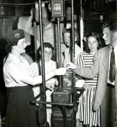 August 2, 1943: On her first trip as conductorette (as they were called at the time), Louise M. Henshon, of Somerville, helped customers from Lake Street to Lechmere Square. Eight conductorettes were hired and trained by the Boston Elevated to ease the manpower shortage brought on by the war. They made history as the first women conductors on the line. A former cosmetic seller, Louise had a brother in the Navy and a fiancee stationed in Guadalcanal.