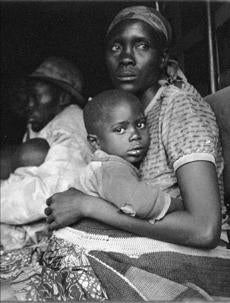 In April, 1995, a Hutu refugee woman and her child huddled in the back of a UNHCR truck at the Butare transit camp.