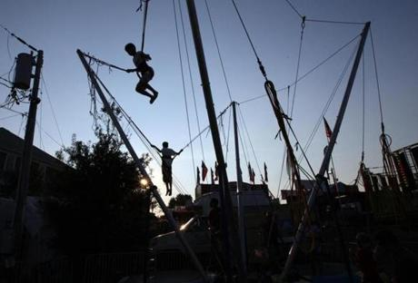 Kids on a bungee ride at the annual Marshfield Fair.