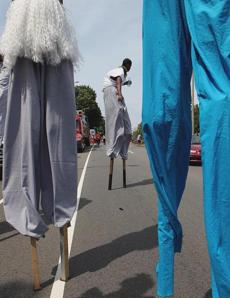 Boston MA 082512 Men on stilts made their way down MLK Bouldevard during the annual Carribean Carnival Parade in Boston, Saturday, August 25 2012. (Globe Staff Photo/Wendy Maeda) section: Metro slug: 26carribean reporter: