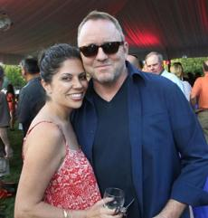 8-25-2012 Norwood, Mass. Over 350 guests attended Ernie Boch Summer Bash 2012 held at his Norwood home. L. to R. are Angie Lehane and her husband Author Dennis Lahane of Brookline Globe photo by Bill Brett