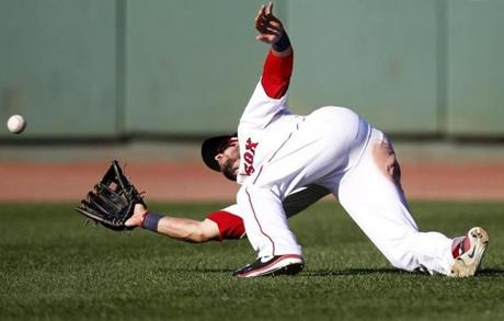 Red Sox fielder Cody Ross makes a diving catch in the top of the eighth inning against the Kansas City Royals at Fenway Park on Aug. 26.