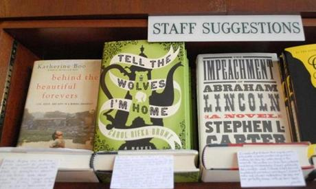 Hand-written reviews are displayed with staff selections at R.J. Julia Booksellers.