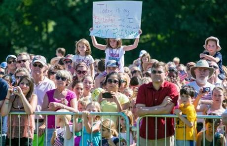 A large crowd gathered to watch the parade, which rolled from the town hall to Needham High School.