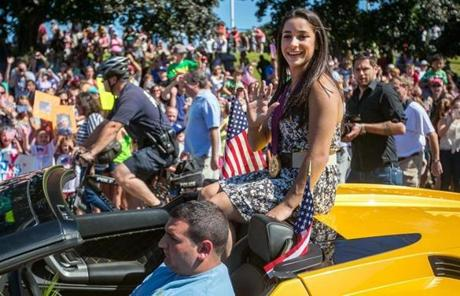 Olympic gold medal gymnast Aly Raisman waved during the parade Sunday.