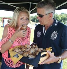 8-26-2012 South Natick, Mass. Over 500 guests attended NECN TV Diner Food Fest held at Belkin Family Lookout Farm, South Natick. L. to R. are TV Diner Host tasting Piantedosi rolls Jenny Johnson and Billy Costa. Globe photo by Bill Brett