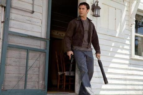 "Joseph Gordon-Levitt stars as a hit man in the time-travel action-thriller ""Looper."""