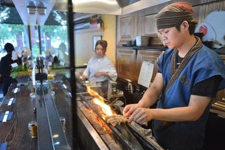 Executive Chef Sho Inoue cooked an order on the special charcoal grill.