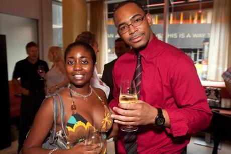 8/27/12 Boston, MA -- From left, Chevon Johnson of Roslindale and Lyndon Boyd of Boston at the opening party for Sip in Downtown Crossing August 27, 2012. Erik Jacobs for the Boston Globe