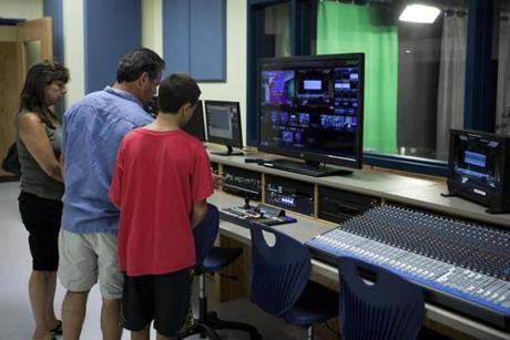 During a tour Tuesday of the new Natick High School, Andre and Max Felz (at right) check out the control board in the facility's television-production studio.