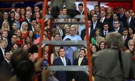 Mitt Romney and running mate Paul Ryan are framed through the photographers' ladder at the GOP convention at the Tampa Bay Times Forum.