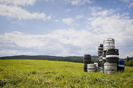 Kegs in a field behind Hill Farmstead Brewery in Greensboro, Vermont. photo by Monica Donovan for the Boston Globe
