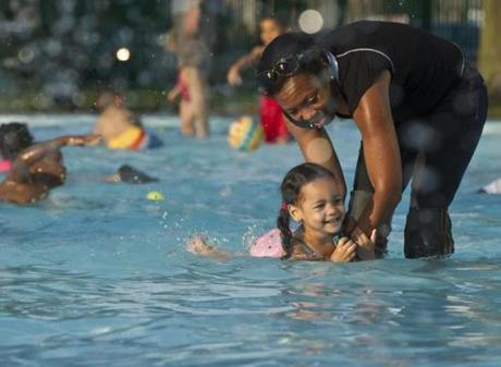 8/31/12 Boston, MA Gina DePasquale (cq) teaching her daughter, Alyssa DePasquale (cq), 2, how to swim at the DCR (Department of Conservatiom and Recreation's Lee Memorial Pool on Thursday August 30, 2012. (Matthew J. Lee/Globe Staff) slug: warm section: metro reporter: