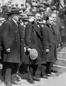 April 11, 1922:  Bartolomeo Vanzetti and Nicola Sacco as they appeared at the Dedham Courthouse on April 10th where they heard the order that they be executed for the murders of Frederick Parmenter and Alessandro Berardelli. In their address to the court, Sacco talked but five minutes apologizing that he was not familiar with the English language. Vanzetti, on the other hand, availed himself of 45 minutes during which he attacked the justice and two juries that had found him guilty. Yet it was during the reading of the execution order to Vanzetti when Sacco leapt from his chair, pointed his finger at Judge Thayer and screamed,