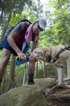 Randy Pierce cupped his hand to form a drinking bowl for his guide dog, The Mighty Quinn.