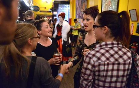 Amanda Palmer, second from right, meets with supporters during an evening that combined an art show and musical performance.