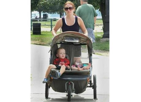 Shannon O'Driscoll of Weymouth strolls around the paths of Castle Island with her kids Michael and Molly.