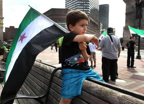 Hady Eid Alawa, 4, of East Hampstead, N.H., waved a flag as local Syrian-Americans rallied in Copley Square against the killing of children in Syria.