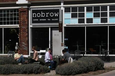 Customers hung out on the patio at Nobrow Coffee & Tea Co. on a sunny spring day.