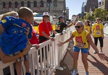 Sarah Burton of Clinton greeted her son, Brody Burton, 4, and her sister, Erin Stick of Newburyport, at the finish line for the Jimmy Fund Walk in Copley Square. Burton was walking for Brody, who is in remission with acute lymphocytic leukemia.