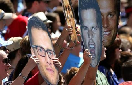 Fans showed the many faces of New England Patriots quarterback Tom Brady during the season opener in Nashville.