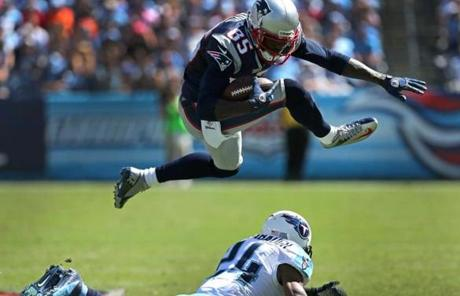 Brandon Lloyd jumped over a defender during the Patriots' victory.