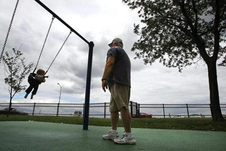 Hovering clouds didn't stop Stephen Dulong from spending outdoor time with his year-old granddaughter, Emma Close, at a park along Quincy Shore Drive in Quincy.