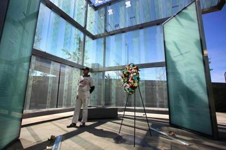 Ken Terrell of Cambridge read the names of those killed on American Airlines Flight 175 and Flight 11 at the Logan Airport 911 Memorial.