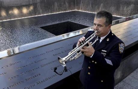 New York City police bugler Gabe Perdomo played next to the 9/11 memorial.