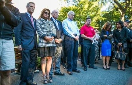 09/11/2012 BOSTON, MA Senator Scott Brown (cq) (left) and his wife Gail Huff (cq) stood with family and friends of those lost on September 11, 2001 as they gathered for the placing of a wreath of ivory flowers at the September 11th memorial in the Garden of Remembrance (cq) at the Boston Public Garden (cq). (Aram Boghosian for The Boston Globe)