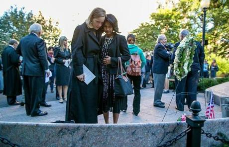 Katie Pakenham (left) and Teresa Mathai consoled each other as family and friends of those lost on Sept. 11, 2001 gathered in Boston.
