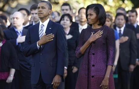 President Barack Obama and first lady Michelle Obama observed a moment of silence on the South Lawn of the White House.