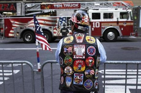A man stood along Trinity Place in New York City before ceremonies began to mark the 9/11 anniversary.