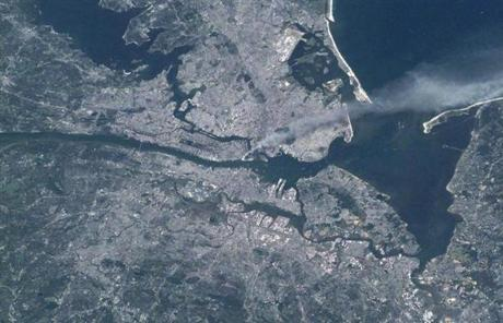 A NASA satellite captured a plume of smoke rising from the World Trade Center in New York City on Sept. 11, 2001.