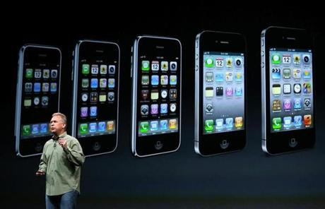 The many generations of iPhones were displayed behind Schiller.
