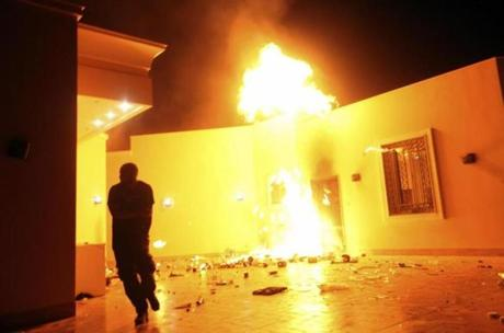 The US compound is seen in flames during the protest by an armed group.