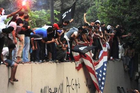 Protesters would eventually tear down the US flag.