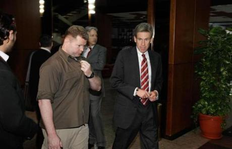 Stevens was accompanied by an unidentified security staffer at meetings with opposition leaders in Benghazi on April 11, 2011.