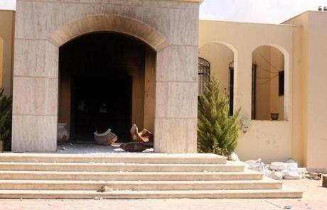 Soot and debris spilled out of the US consulate in Libya after an attack the previous night. Stevens and three other Americans were killed.