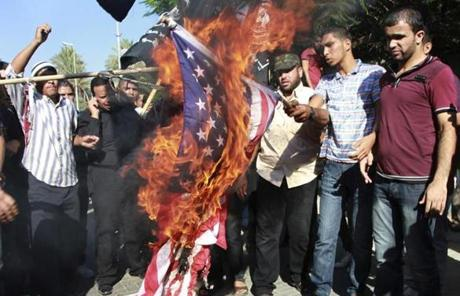 Palestinians burned a US flag  Wednesday during a protest against the movie,