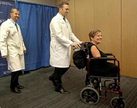 Drs. Bohdan Pomahae and Simon G. Talbot headed to a news conference with patient Katy Hayes to explain the double arm transplant procedure that she will undergo at Brigham and Women's Hospital.