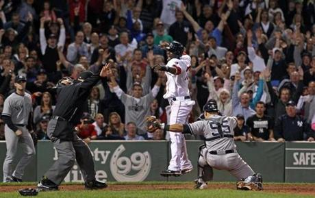 Pedro Ciriaco leaped for joy after he beat the throw to Yankees catcher Russell Martin (55) to score the winning Red Sox run in the bottom of the ninth inning on a single by teammate Jacoby Ellsbury at Fenway Park.