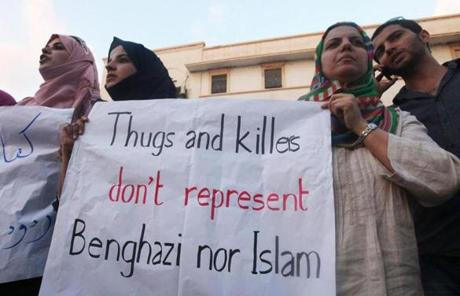 Demonstrators in Benghazi, Libya, held a sign during a rally a day after an attack on the US consulate there killed four US diplomats.