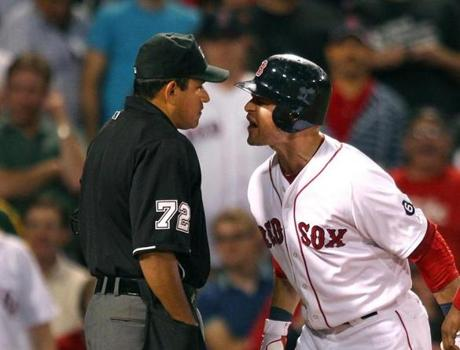 Cody Ross argued with the umpire after being called on a third strike in the 8th inning as the Red Sox played the New York Yankees at Fenway Park. Ross was thrown out of the game.