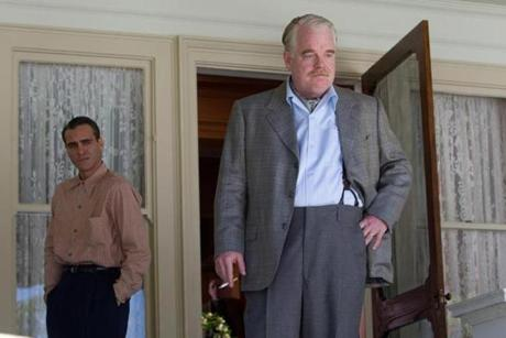 "Joaquin Phoenix (left) as Freddie Quell and Philip Seymour Hoffman as Lancaster Dodd in ""The Master."""