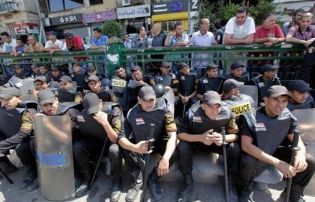 Police rested while clearing Tahir Square of protesters in Cairo.