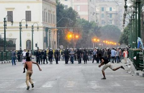 Egyptian protesters hurled stones at riot police in Cairo.