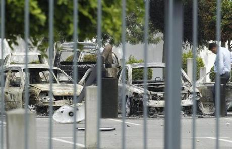 A policeman checked vehicles damaged inside the US Embassy in Tunisia.